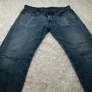 Distressed Levi's 513 Jeans